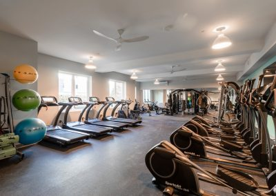 Gym with weightlifting equipment, treadmills, and ellipticals at the Residences at Bentwood in Plymouth Meeting