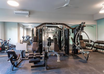 Weightlifting machines in the gym at Residences at Bentwood in Plymouth Meeting