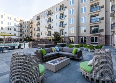 Outdoor lounge and dining area with fire pits at the Residences at Bentwood